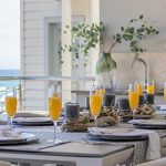Outdoor table set for breakfast with mimosas