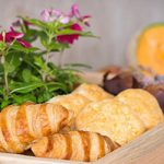 Close-up of croissants in a wooden basket