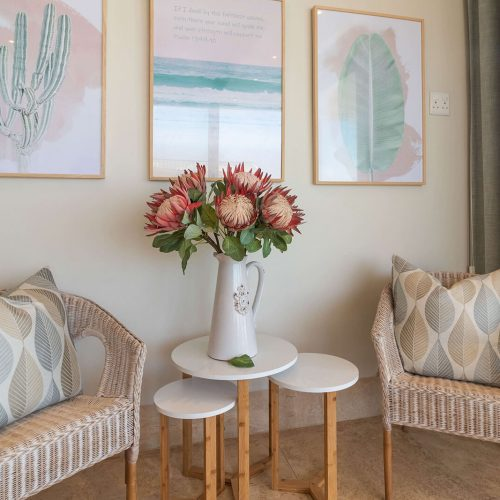 Wicker chairs and a bouquet of proteas